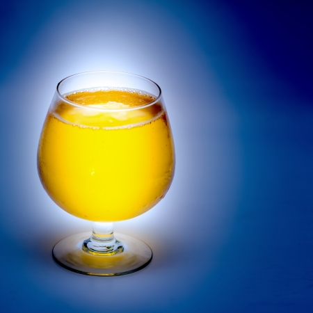 Beer in a wine glass On light blue background photo