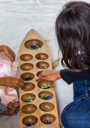 played: mancala games children played in Thailand