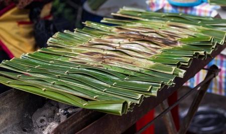 sweetmeat: Kanom Jark, Thai sweetmeat made of flour, coconut and sugar with nipa plam leaves