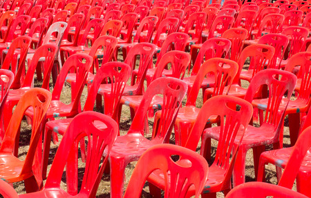 Red chairs arranged for an outdoor event  photo