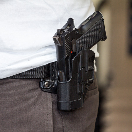 holster: Pistol in the holster at the waist of the man