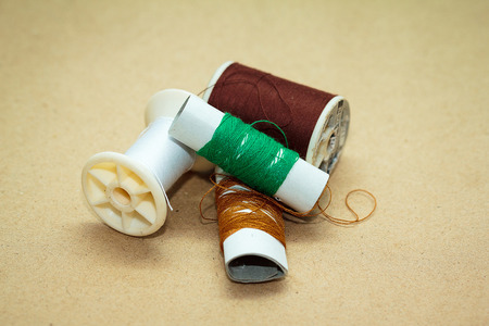 Thread on a brown paper background Stock Photo - 26307301