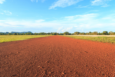 earth road: Red earth road in the morning.