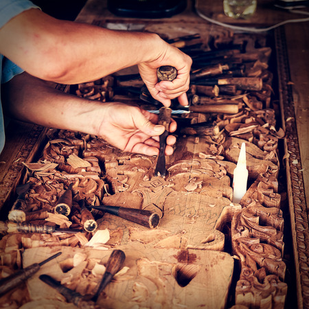 engraver: wood engraver at work for woodcut   Stock Photo