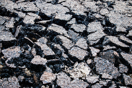 roughing: Road surface cracks from the running of the car  Stock Photo