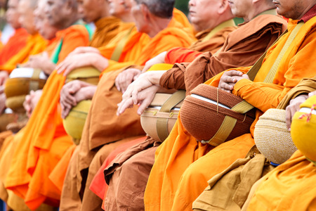 public offering: Satun, Thailand - December 30, 2014, at 07.30 AM: public offering food to monks. On the eve of the New Year to be reached. In Satun, Thailand will have merit by giving food to monks held annually.
