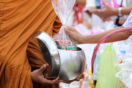 annually: Satun, Thailand - December 30, 2014, at 07.30 AM: public offering food to monks. On the eve of the New Year to be reached. In Satun, Thailand will have merit by giving food to monks held annually.