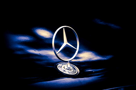 superleggera: Songkhla, Thailand - 11 January 2015: Logo Mercedes-Benz. Parked under a tree at the temple Pha Kho tourist sites. In Songkhla, Thailand Editorial