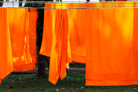 hung: Washed and hung Clothes of buddhist Monks.
