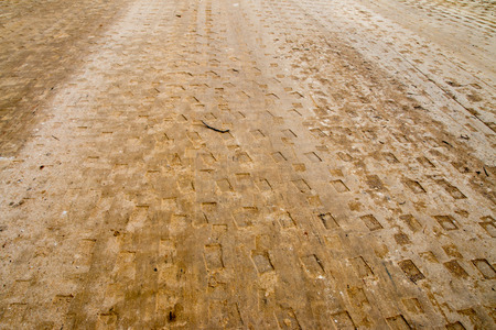 compacted: Surface soil is compacted by a car. To build a new road
