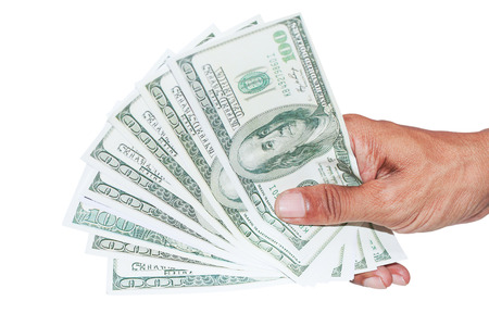 over paying: hand with dollar banknotes isolated background.