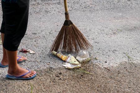sanitation: sanitation worker cleaning the street