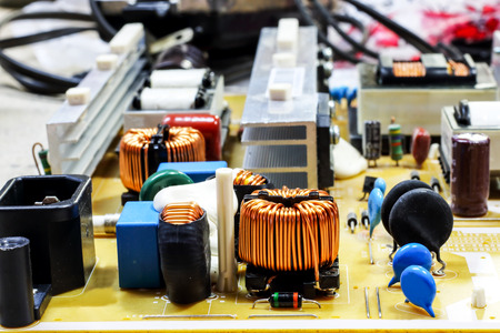 electromagnetism: micro coil and capacitors mounted on base plate Stock Photo