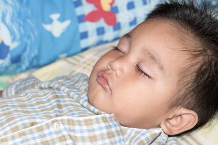 animal angelic: The boy was sleeping with happiness. Stock Photo