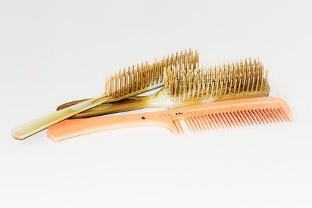 acrylic fiber: hair combs old dirty on acrylic textile fiber