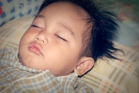 animal angelic: Vintage The boy was sleeping with happiness.