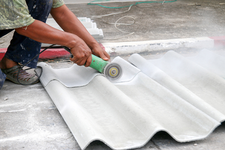 granger: Workers are cutting tile roof