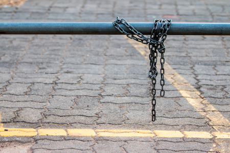 manacle: Chain laid across  steel lock for bicycles, motorcycles lost.
