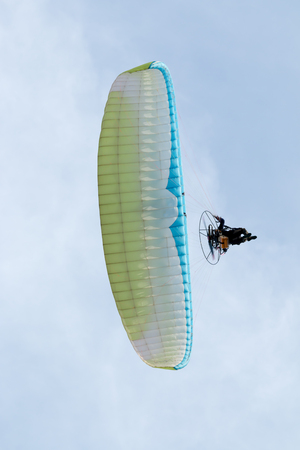 Paramotor on the sky in the morning.