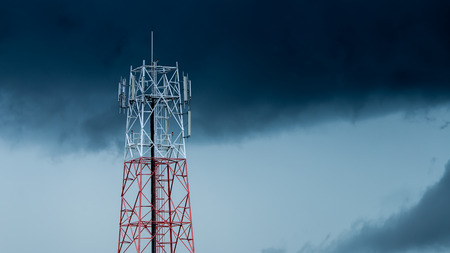 Cell phone tower and the Rain clouds background.