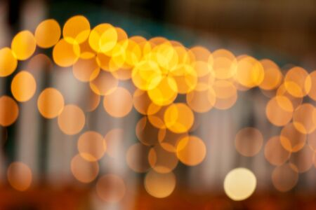 Abstract background Yellow bokeh lights.