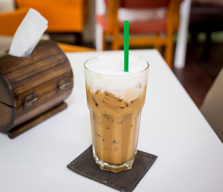 Iced coffee with straw in plastic cup Stock Photo