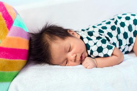 nappy new year: Infant baby boy sleeping peacefully