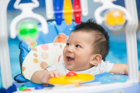 Portrait of a happy baby playing with toys. Stock Photo
