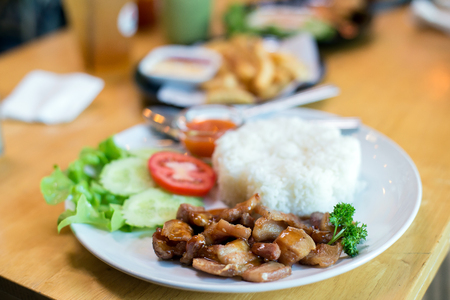 Streaky pork fried with rice Imagens