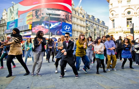 piccadilly: Performers street dance London 2012 -young people dancing Gangnam Style on London Piccadilly Circus Editorial