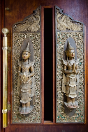 old wooden door engraved in thai art style photo