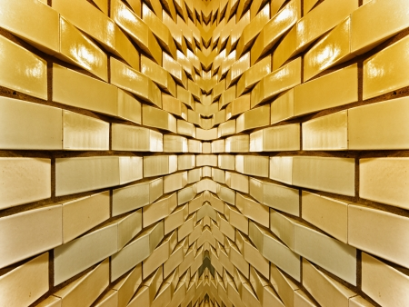 symmetrical wall made from gold bricks  photo