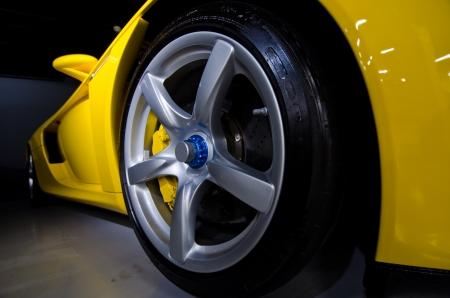 luxury car: Wheel from porsche perspective under car