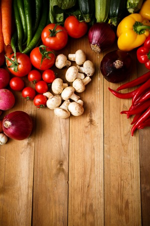 raw vegetables: Healthy Organic Vegetables on a Wooden Background Stock Photo