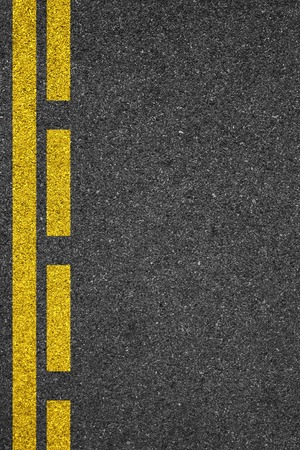 yellow on line: Asphalt as abstract background Stock Photo