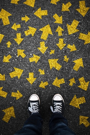 Unstable arrows on asphalt Stock Photo - 36492209