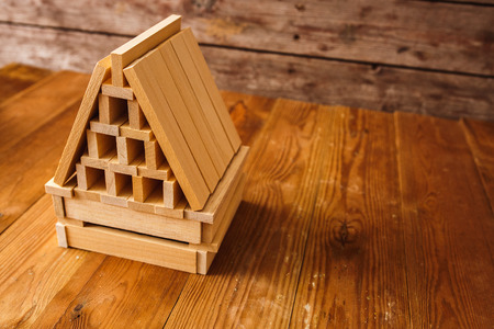 dollhouse: Wooden Block House on wooden table