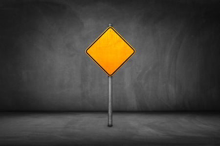 yield sign: Street Sign: blank yellow road sign with street wall.