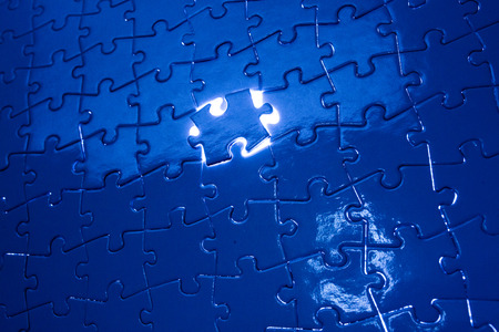 red puzzle piece: Jigsaw puzzle Stock Photo