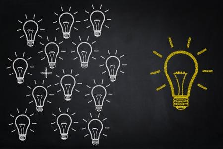 contemplation: Idea Bulbs drawing on chalkboard Stock Photo
