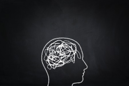 Mess symbol human head on blackboard.