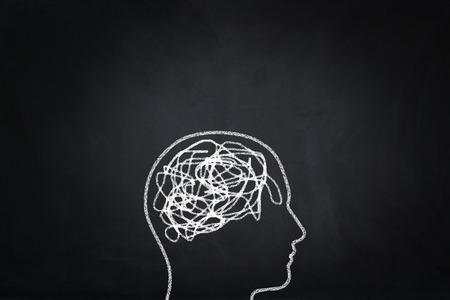 mess: Mess symbol human head on blackboard.