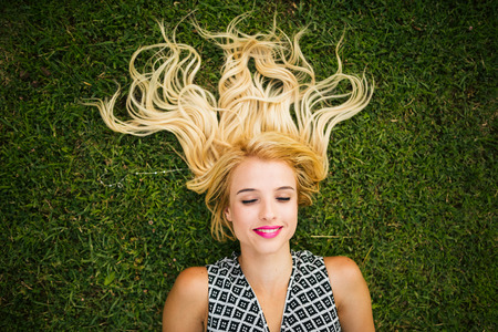 woman from behind: Young blonde woman summer day relaxing. Stock Photo