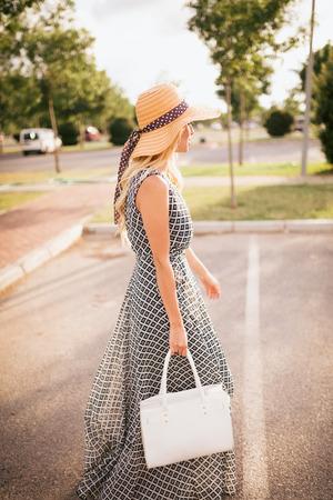 sunhat: Lovely blonde woman with a sunhat.