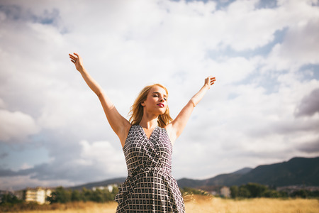 outstretched: Young blonde woman arms outstretched. Stock Photo