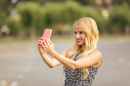 only teenage girls: Young woman take his photo - Selfie