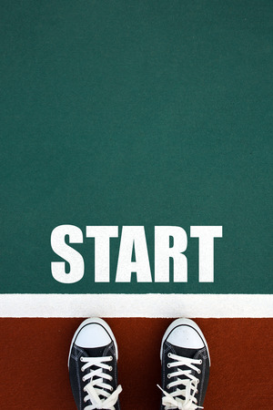 starting line: People at a starting line with start text on floor Stock Photo