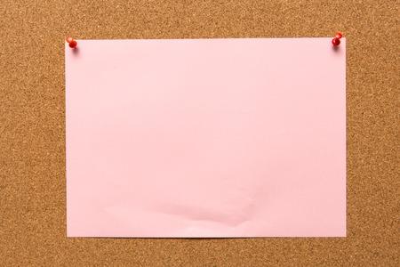 Paper note on corkboard. Reklamní fotografie