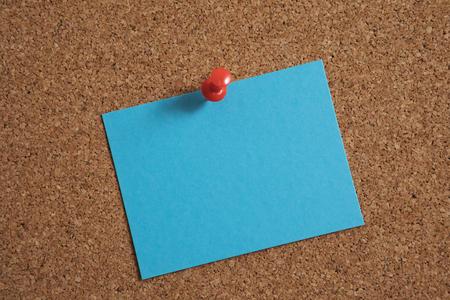 Green sticky note on bulletin board.