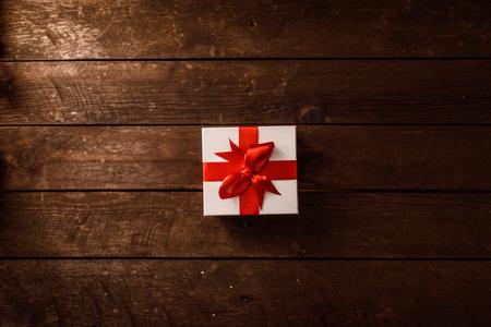 Christmas gift on wood.